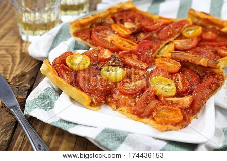 Tomato tart and two glass of white wine