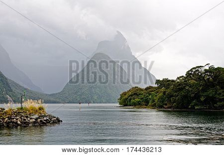 Mitre Peak in the Milford Sound on an overcast foggy day - South Island, New Zealand