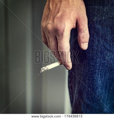 Toned Photo of Person hold a Cigarette in the Hand closeup