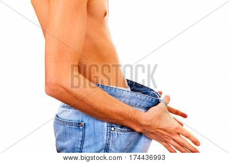 Skinny Young Man in the Jeans Isolated on the White Background