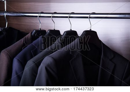 Row of men's suit jackets. Suits for business