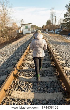 girl goes on railway spring into the distance
