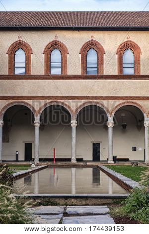 Milan (Lombardy Italy): the medieval castle known as Castello Sforzesco: a court with water and portico