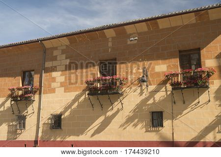 Leon (Castilla y Leon Spain): historic building in Calle San Pedro with balconies and flowers