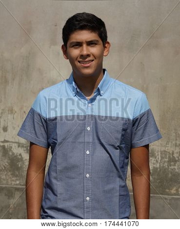 Young Teen Hispanic Boy Standing near Wall