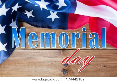 patriotism and national holidays concept - memorial day words over american flag on wood
