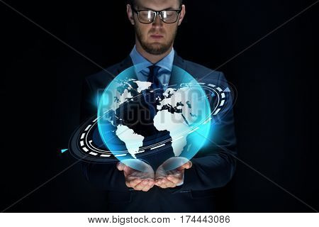 business, future technology, mass media, cyberspace and people - businessman with virtual earth projection over black background