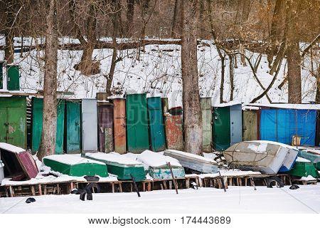 Winter Landscape With Fisherman Boats Lying On Frozen Lake Shore
