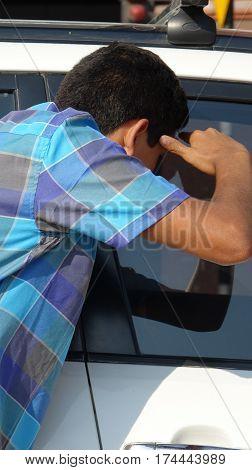 Burglar Looking In Car Window Young Teen