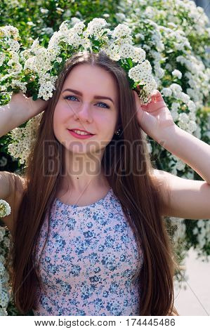 Beautiful Girl Holding Wreath Of White Flowers On Head.