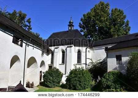 Gothic castle Rostejn near the village Doupe, stands on a rocky hill in the romantic landscape, Czech republic