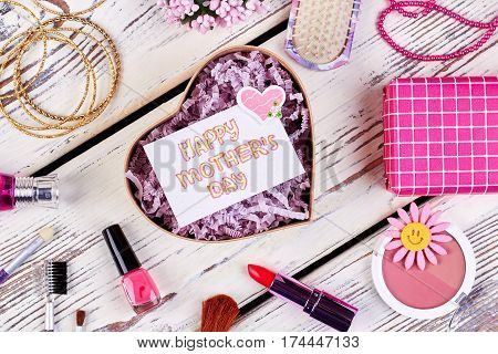 Jewelry and cosmetics on wood. Useful presents for mother.