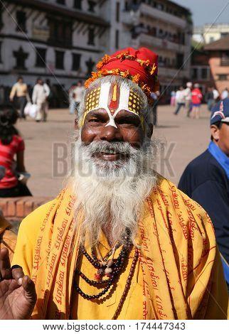 KATHMANDU, NEPAL. 23 September 2008: Closeup portrait of monk - sadhu in the square in Kathmandu. Patan, Durbar Square, Nepal