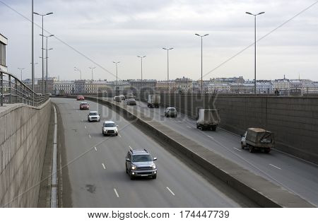 on the road on the overpass riding cars city buildings in the background cloudy day St. Petersburg the pillars lights cityscape