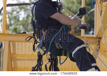 Rope access irata worker, industrial engineer, workman