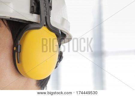 Man wearing safety helmet and hearing protection