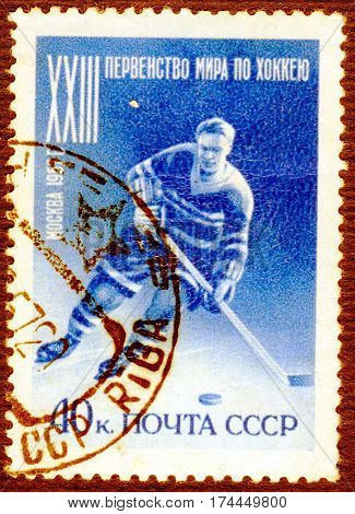 USSR - CIRCA 1957: Postage stamp printed in USSR  with a picture of a hockey player, with the inscription