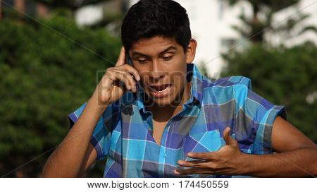 Angry Teen Boy Talking On Cell Phone