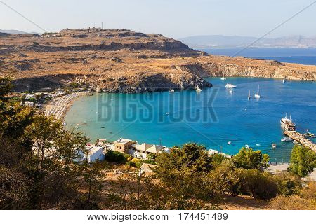 Beautiful day overlooking the main beach at Lindos on the Island of Rhodes Greece