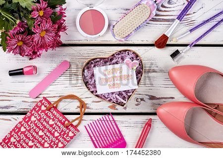 Set of cosmetics and flowers. Gift for beloved mother.