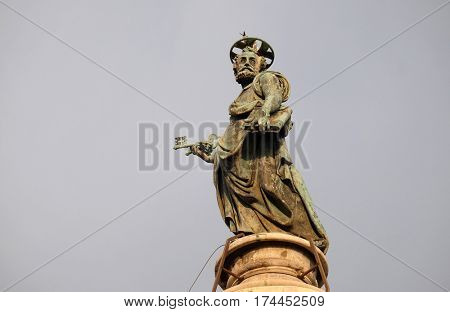 ROME, ITALY - SEPTEMBER 01, 2016: Bronze statue of St Peter, Church of the Most Holy Name of Mary (Chiesa del Santissimo Nome di Maria al Foro Traiano) at the Trajan Forum -  church in Rome