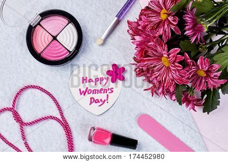 Blusher, flowers and nail polish. Choose present for woman.