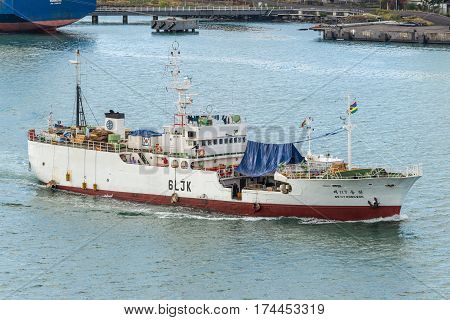 Port Louis Mauritius - December 12 2015: Large Fishing Vessel DONG WON NO.117 sailing at Port Louis Mauritius. Port Louis was already in use as a harbor in1638.