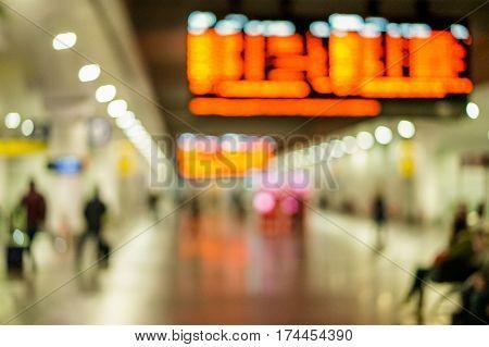 Blurred people on high speed train metropolitan station - Defocused photo - City underground view - Blurry background