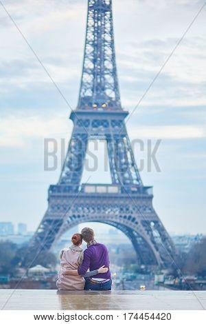 Couple Near The Eiffel Tower In Paris, France