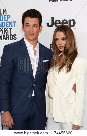 LOS ANGELES - FEB 25:  Miles Teller, Keleigh Sperry at the 32nd Annual Film Independent Spirit Awards at Beach on February 25, 2017 in Santa Monica, CA