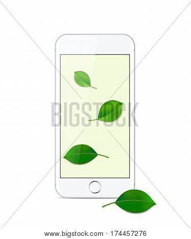 White modern smartphone on a white background with green leaves