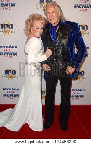 LOS ANGELES - FEB 26:  Tanya Tucker, Peter Nygard at the 27th Annual Night of 100 Stars Oscar Viewing Gala at the Beverly Hilton Hotel on February 26, 2017 in Beverly Hills, CA