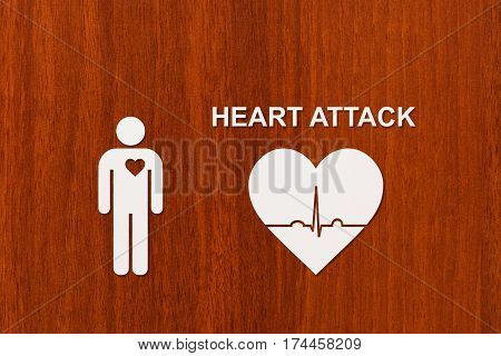 Paper man with echocardiogram and HEART ATTACK text. Medical cardiology concept