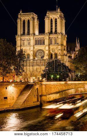 Notre Dame de Paris cathedral illuminated at twilight with the Seine River and the Petit Pont. Ile de La Cite. 4th Arrondissement Paris France