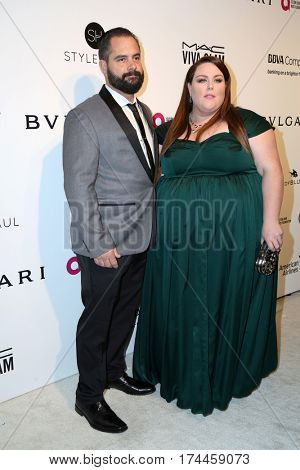 LOS ANGELES - FEB 26:  Josh Stancil, Chrissy Mertz at the 25the Annual Elton John Academy Awards Viewing Party at the  City of West Hollywood Park on February 26, 2017 in West Hollywood, CA