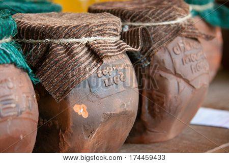 Abkhazia wild honey in Clay pot with cloth.