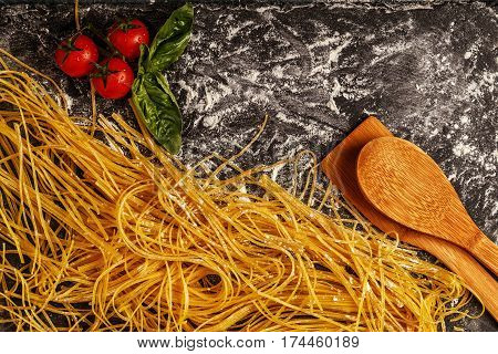 Raw fresh homemade pasta spaghetti top view.