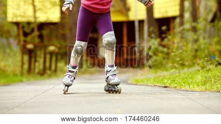 child rollerblading outdoors. sport lifestyle. roller skating