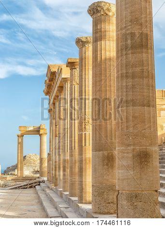 Ancient columns on Lindos island, Greece. Vertical shot