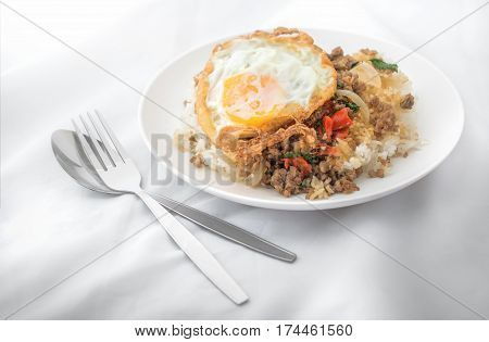 Fried basil leave with meat Fried egg on rice spicy thai food.
