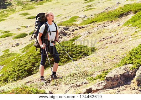 trail in the mountains. a hiker in the mountain. Climb to the top. mountaineering