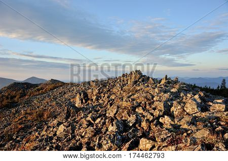 sunrise on the top of the mountain rocky peack of mountain pile of stones
