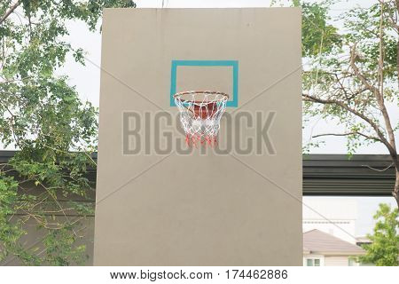Close up of basketball hoop and net. For concepts such as sports and exercise and healthy lifestyle.