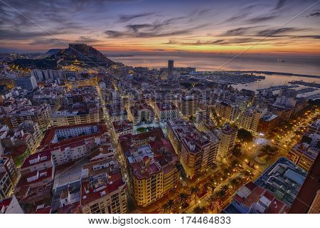 sunrise over the ancient city of Alicante in Spain and in the background the castle and harbor