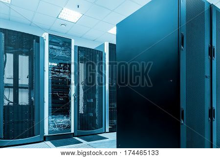Modern network and telecommunication technology computer concept: server room in the datacenter