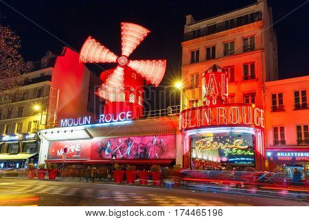 Paris, France - December 28, 2016: The picturesque famous cabaret Moulin Rouge located close to Montmartre in the Paris red-light district of Pigalle on boulevard Clichy at night, Paris, France