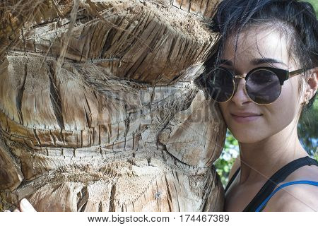 Beautiful Girl. Girl With A Palm Tree