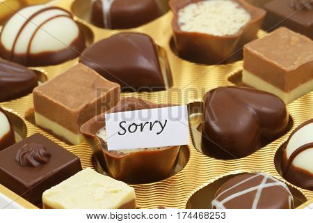 Sorry card with box of assorted chocolates