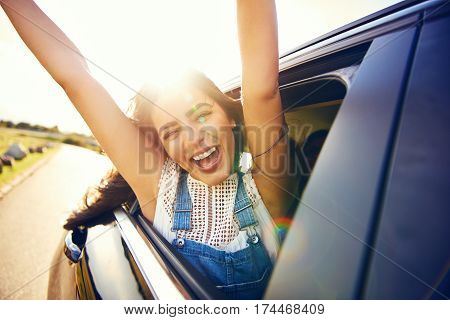 Exuberant Young Woman Celebrating Her Vacation
