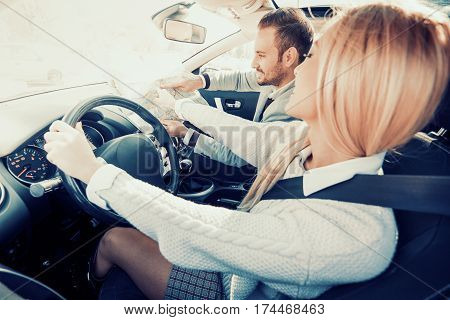 Smiling man and woman using map on roadtrip. Leisure road trip travel and people concept.